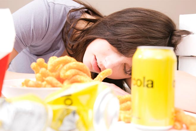 Why do I feel so exhausted after a large meal?